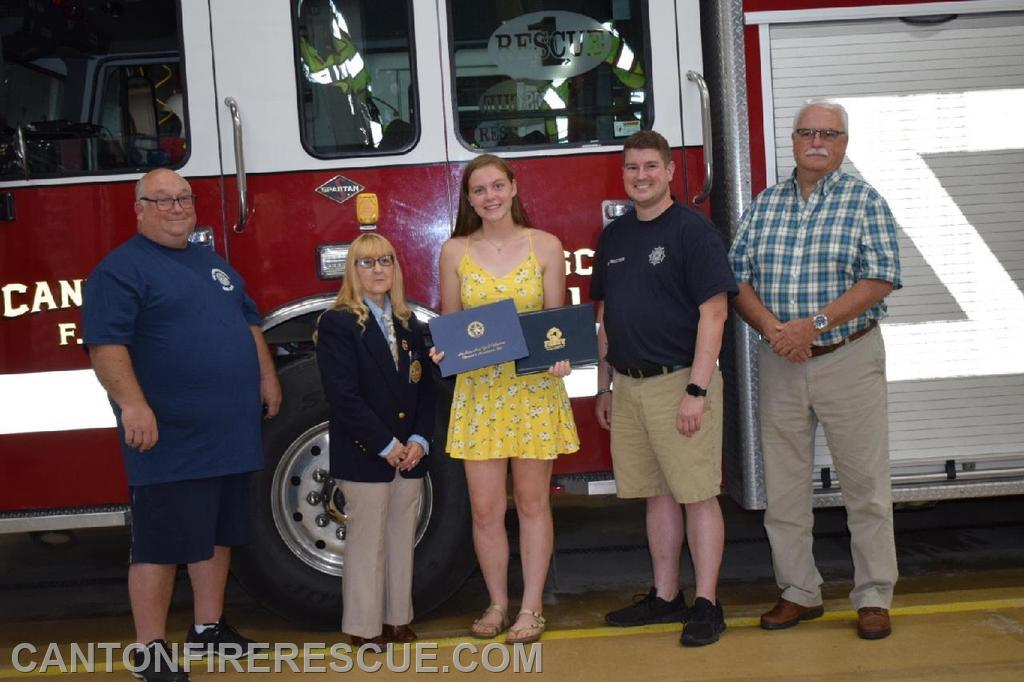 FF Brooke Larrabee being presented with scholarships by FASNY Director Laurie Hance.